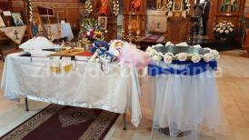 Faptă creştină de Adormirea Maicii Domnului Patru copii aflaţi în asistenţă maternală, botezaţi la Cumpăna